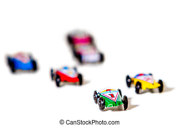 Mini car racers evoke memories - semi isolated background