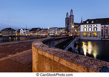 View on Grossmunster Church and Munsterbrucke Bridge in the...