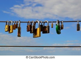 Padlocks on a bridge - Padlocks as a sign of eternal love on...