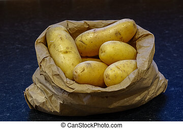 Clean New Potatoes In A Brown Paper Bag