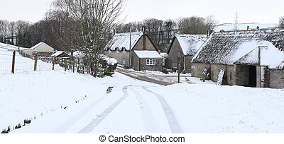 Winter snow - Abbotsbury village covered in snow in rural...