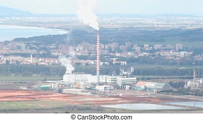 chimney with grey smoke - chimney of an industrial plant...