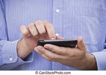 Casual businessman operates a touchscreen smartphone 2