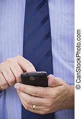 Businessman uses touchscreen smartphone