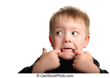 Cute young boy making funny face