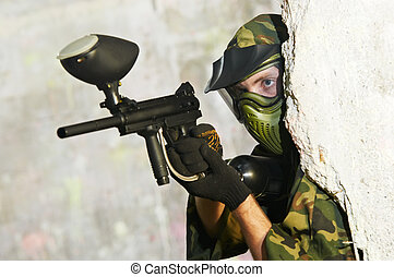 paintball player under cover