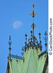 Old building roof and moon in Ottawa, Canada