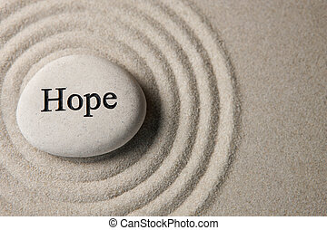 Hope - Inspirational stone surrounded by sand ripples. Zen...
