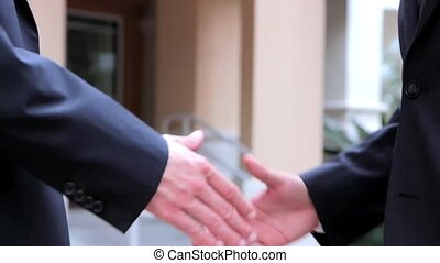 Businessmen shaking hands business deal partnership high...