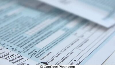 Signing a 1040 income tax return form