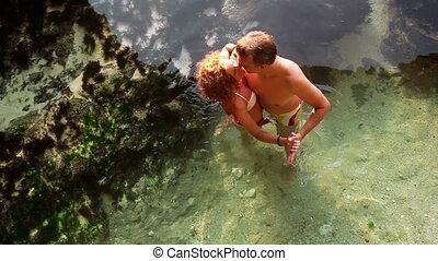 Dancing in ocean - Happy couple dancing together in ocean...