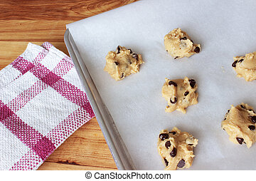 Cookie Dough 6 - A close-up image of a cookie sheet lined...