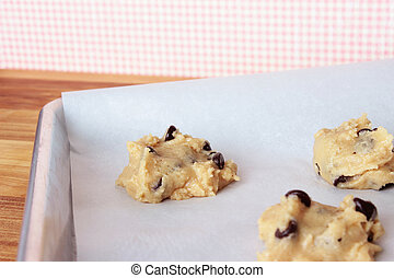 Cookie Dough 9 - A close-up image of a cookie sheet lined...