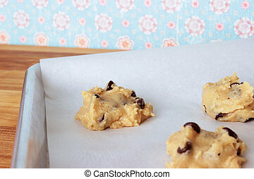 Cookie Dough 11 - A close-up image of a cookie sheet lined...