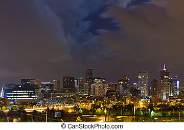 Moon Behind Clouds Above The Denver Skyline - Denver skyline...