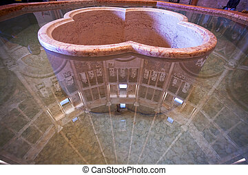 font-stone with water in The Baptistery of Parma - PARMA,...
