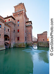 side view of moat and Castello Estense in Ferrara, - side...