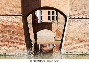 moat and bridges of Castle Estense in Ferrara, Italy