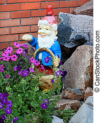 Garden gnome with a basket of flowers and stones against a...