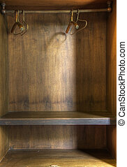 Bare cupboard - The inside of an empty wooden wardrobe