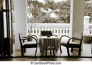 Coffee table and chairs on a balcony