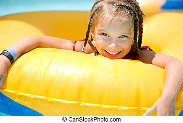 Little girl sitting on inflatable ring - Little girl sitting...