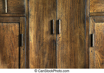 Cupboard - Rich texture on the doors of an old wooden...
