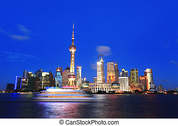 Shanghai Pudong cityscape at night viewed from the Bund -...