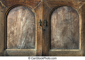 Wooden cupboard - Doors on an old wooden cupboard with grain...