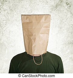 Hidden behind paper bag - head in the paper bag, man hidden...