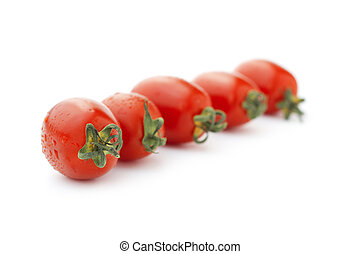 row of cherry tomatoes on white background