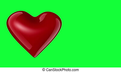Red heart rotating on the greenscreen background