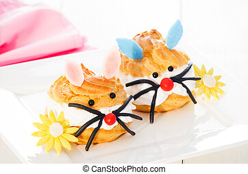 two cream puff decorated as girl bunny and boy bunny
