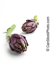 close up of artichokes isolated on white background