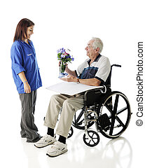 Receiving Flowers - An elderly man in a wheelchair happily...