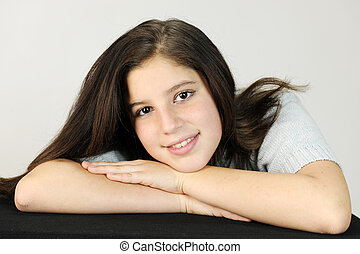 Relaxed Tween - Close-up of a pretty preteen resting her...