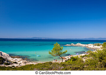 Portokali beach, Halkidiki, Greece with Athos mount on...
