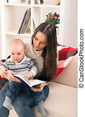 mother with son reading book