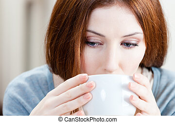 Attractive girl with cup of tea - Woman with cup of tea has...