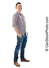 Cheerful full body Asian man standing isolated on white...