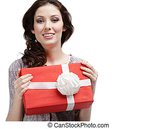 Young woman hands a gift with white bow