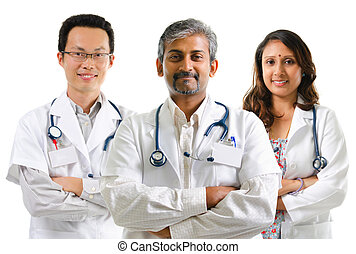 Multiracial doctors medical team crossed arms standing on...