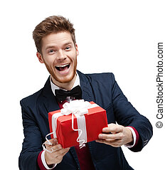 Funny man passes a present - Funny man passes a gift wrapped...