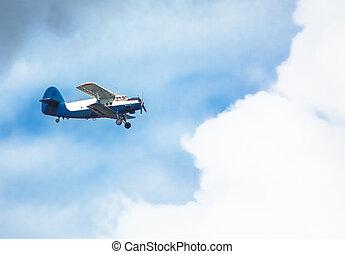 propeller biplane - Biplane in blue Sky over clouds