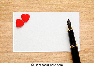 Blank Valentine card with two hearts and fountain pen