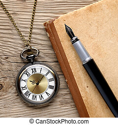 Antique watch, fountain pen and notebook