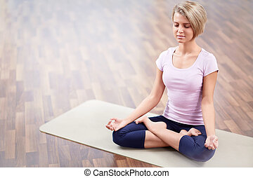 Meditation - Young woman in a lotus position