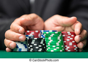 "Gambler going ""all in"" pushing his chips forward"