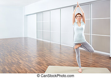 Yoga position - Young woman in yoga position