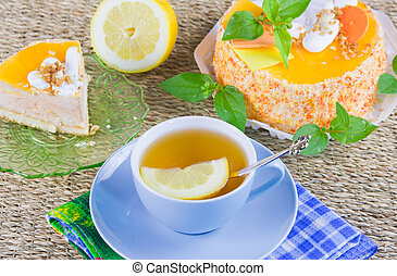 a delicious sweet cake is beautifully decorated and cup of...